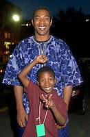 July 12 2002, Montreal, Quebec, Canada<br /> <br /> FEMI KUTI  and his son pose for an exlcusive photo before Femi concert at  the Spectrum, in Montreal, Canada, July 12, 2002 during the Nuits d'afrique Festival.<br /> <br /> The princely son of indomitable Fela is now an Afrobeat king in his own right. Traditional Yoruba rhythms and melodies are married to funk and jazz, soul, salsa and hip hop. Femi's latest release is aptly titled Fight To Win.<br /> <br /> Mandatory Credit: Photo by Pierre Roussel- Images Distribution. (©) Copyright 2002 by Pierre Roussel <br /> <br /> NOTE : <br />  Nikon D-1 jpeg opened with Qimage icc profile, saved in Adobe 1998 RGB<br /> .Uncompressed  Uncropped  Original  size  file availble on request.