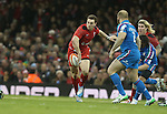 Wales wing George North looks for support inside as Mauro Bergamasco and Leonardo Ghiraldini close in.<br /> RBS 6 Nations 2014<br /> Wales v Italy<br /> Millennium Stadium<br /> 01.02.14<br /> <br /> &copy;Steve Pope-SPORTINGWALES
