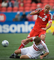 16 May 09: Chicago Fire defender Brandon Prideaux #6 and Toronto FC forward Danny Dichio #9 in action at BMO Field in a game between the Chicago Fire and Toronto FC..Chicago Fire won 2-0..
