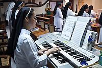 Sister Gertrude playing keyboard during the prayers session for the victims of Tacloban.<br /> <br /> Soeur Gertrude joue du clavier lors de la séance de prières pour les victimes de Tacloban.