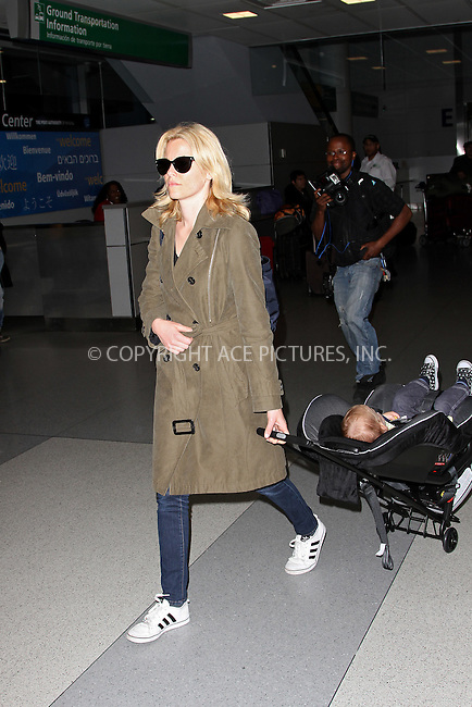 WWW.ACEPIXS.COM . . . . .  ....May 6 2012, New York City....Actress Elizabeth Banks wheels her son Felix Handelman through JFK airport on May 6 2012 in New York City....Please byline: John Peters - ACE PICTURES.... *** ***..Ace Pictures, Inc:  ..Philip Vaughan (212) 243-8787 or (646) 769 0430..e-mail: info@acepixs.com..web: http://www.acepixs.com