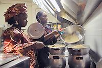 """- a small community of Tuareg, the legendary """"blue men"""" of Sahara, coming from, Niger has settled in Pordenone, town of Italian northeast, being able to achieve a good degree of integration although in the respect of their traditional culture; two women, Tounfana and Laglaga in the kitchen of a restaurant prepare traditional foods in occasion of a festivity....- una piccola comunità di Tuareg, i leggendari """"uomini blu"""" del Sahara, provenienti dal Niger, si sono stabiliti a Pordenone, città del nord-est italiano, riuscendo a conseguire un buon grado di integrazione pur nel rispetto della loro cultura tradizionale; due donne, Tounfana and Laglaga, nella cucina di un ristorante preparano cibi tradizionali in occasione di una festa"""