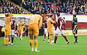 MOTHERWELL'S KEITH LASLEY (14) IS SENT OFF AFTER RECEIVING A SECOND YELLOW FOR A LATE CHALLENGE ON HEARTS' ARVYDAS NOVIKOVAS
