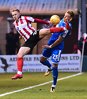 Lincoln City's Danny Rowe is fouled by Notts County's Daniel Jones<br /> <br /> Photographer Andrew Vaughan/CameraSport<br /> <br /> The EFL Sky Bet League Two - Lincoln City v Notts County - Saturday 13th January 2018 - Sincil Bank - Lincoln<br /> <br /> World Copyright &copy; 2018 CameraSport. All rights reserved. 43 Linden Ave. Countesthorpe. Leicester. England. LE8 5PG - Tel: +44 (0) 116 277 4147 - admin@camerasport.com - www.camerasport.com