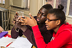Education High School male and female student conducting experiment in science class