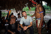 Xingu Indigenous Area, Brazil. Sting and Raoni in the Men's Hut at Capoto village with other Kayapo Megranoti tribesman.