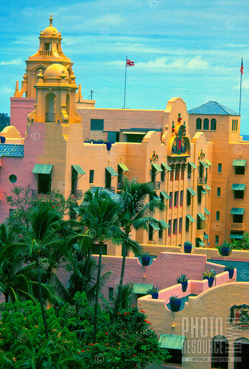 The bell tower, crests and upper portions of the Royal Hawaiian Hotel shot from an adjoining hotel.