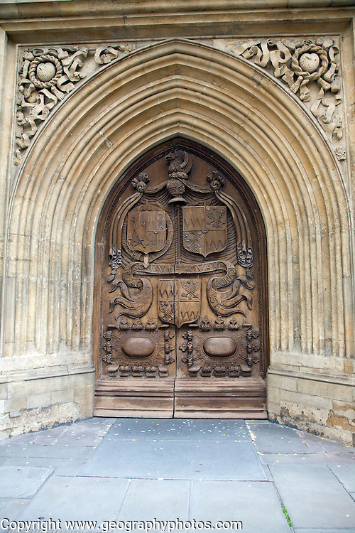 Wooden carved door of the abbey church, Bath, England