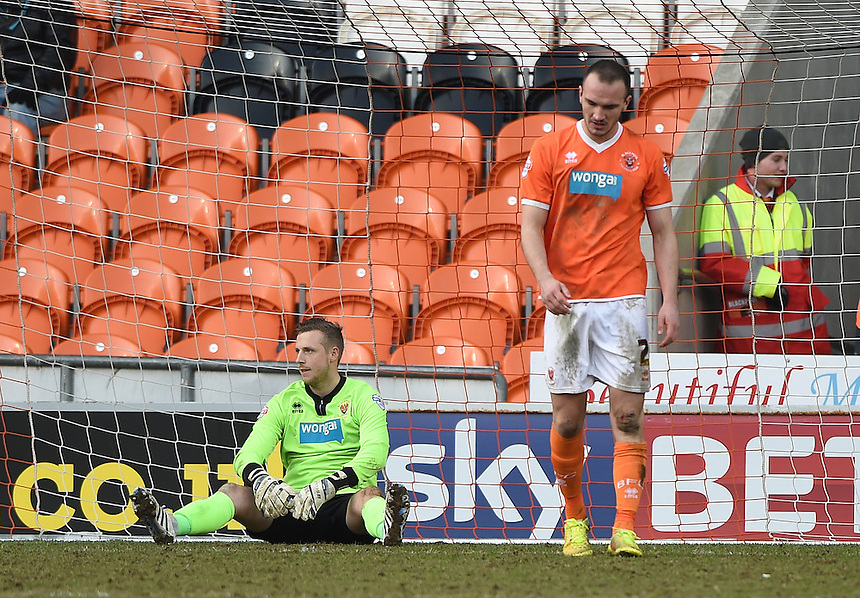Blackpool's Elliott Parish and Tom Aldred look dejected after Sheffield Wednesday take the lead at 1-0<br /> <br /> Photographer Dave Howarth/CameraSport<br /> <br /> Football - The Football League Sky Bet Championship - Blackpool v Sheffield Wednesday - Saturday 7th March 2015 - Bloomfield Road - Blackpool<br /> <br /> &copy; CameraSport - 43 Linden Ave. Countesthorpe. Leicester. England. LE8 5PG - Tel: +44 (0) 116 277 4147 - admin@camerasport.com - www.camerasport.com