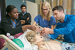 Fourth-year medical students work together to figure out a patient's ailment and administer the proper treatment in the Simulation ICU of the Trent Semans Center for Health Education. From left are Roselyn Appenteng, Bilal Ashraf, Gillian Smelick, and Christophe Hansen-Estruch.