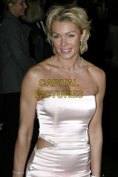 "NELL McANDREW.""Ladies in Lavender"" Royal Film Performance and premiere, Odeon Leicester Square, London, .November 8th 2004..half length pink satin strapless dress cut out waist.Ref: AH.www.capitalpictures.com.sales@capitalpictures.com.©Capital Pictures."