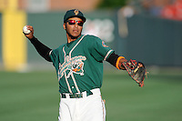 Infielder Rehiner Cordova (16) of the Greensboro Grasshoppers warms up before a game against the Greenville Drive on Wednesday, May 7, 2014, at Fluor Field at the West End in Greenville, South Carolina. Greenville won, 12-8. (Tom Priddy/Four Seam Images)