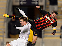 Maryland Terrapins midfielder Dan Metzger (7) goes over the top of Notre Dame Fighting Irish midfielder Nick Besler (8) while going for a header. The Notre Dame Fighting Irish defeated the Maryland Terrapins 2-1 during the championship match of the division 1 2013 NCAA  Men's Soccer College Cup at PPL Park in Chester, PA, on December 15, 2013.