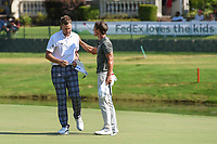 Ian Poulter (GBR) shakes hands with Thorbjorn Olesen (DEN) on 18 following round 4 of the WGC FedEx St. Jude Invitational, TPC Southwind, Memphis, Tennessee, USA. 7/28/2019.<br /> Picture Ken Murray / Golffile.ie<br /> <br /> All photo usage must carry mandatory copyright credit (© Golffile | Ken Murray)