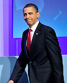 United States President Barack Obama smiles as he walks to the podium to conduct a press conference following the Nuclear Security Summit at the Washington Convention Center in Washington, D.C. on Tuesday, April 13, 2010.Credit: Ron Sachs / CNP