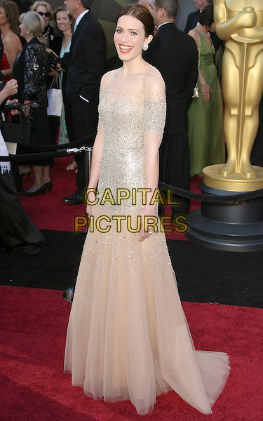 MANDY MOORE in Monique LHuillier.83rd Annual Academy Awards - Arrivals held at the Kodak Theatre, Hollywood, California, USA, 27th February 2011..oscars full length gold sheer mesh sleeves maxi tulle cream beige sequined sequin dress .CAP/RKE/DVS.©DVS/RockinExposures/Capital Pictures.