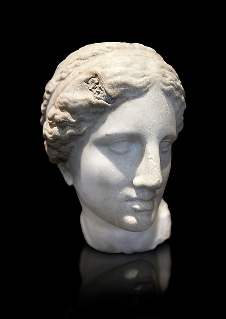 The Kaufmann Aphrodite head. 2nd century Roman marble copy modelled on the statue head of Aphrodite of Cnidus by Praixitele. Many Roman replicas exist of the Aphrodite of Cnidus which is one of the most famous statues of antiquity. The statue depicts the goddess bathing with a vase of water beside her. The lost original is a Hellenistic Greek sculpture made in 360-350 BC which is attributed to Athenian sculpture Praxiteles. Tradition has it that the model for the original was the lover of sculptor Phryne. The original is the oldest known female nude in Greek sculpture. Borghese Collection, Louvre Museum, Paris. Inv no MR657 ( Usual No Ma 421)