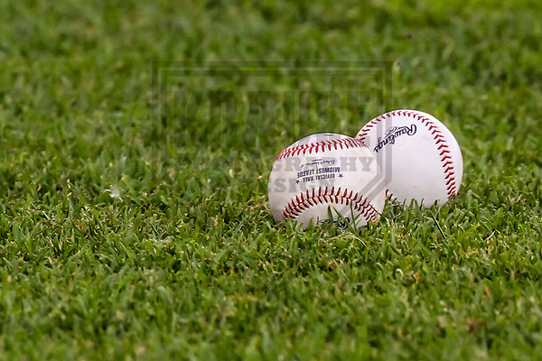 A pair of baseballs sit on the field prior to a Midwest League game between the Quad Cities River Bandits and the Wisconsin Timber Rattlers on June 8, 2017 at Fox Cities Stadium in Appleton, Wisconsin.  Wisconsin defeated Quad Cities 8-3. (Brad Krause/Krause Sports Photography)