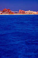 """View of beach properties in Cancun, Mexico (Orange building is """"Baccara"""", Caribbean Sea, Cancun, Mexico"""