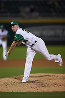 Caballeros de Charlotte relief pitcher Hunter Schryver (34) follows through on his delivery against the Buffalo Bisons at BB&T BallPark on July 23, 2019 in Charlotte, North Carolina. The Bisons defeated the Caballeros 8-1. (Brian Westerholt/Four Seam Images)