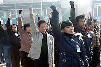 Young salesmen exercise and shout their company slogan in a town square in Linfen city, Shanxi province, China. Workers are paid a low basic salary plus commission for all sales they made..