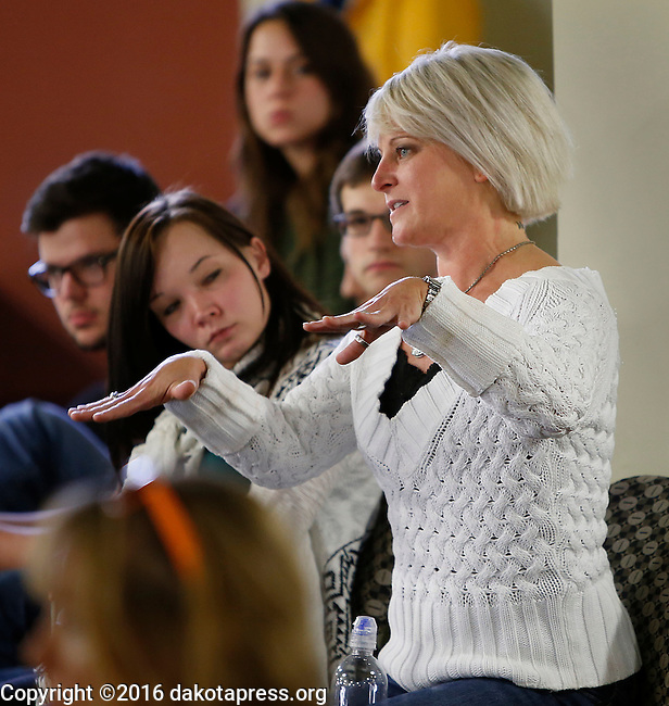 SPEARFISH, SD - OCTOBER 20, 2016 -- Black Hills State University sociology instructor Nicole Royer asks a question of Bill Weld during a campaign stop for the Libertarian vice-presidential candidate at the student union Thursday.  (Photo by Richard Carlson/dakotapress.org)