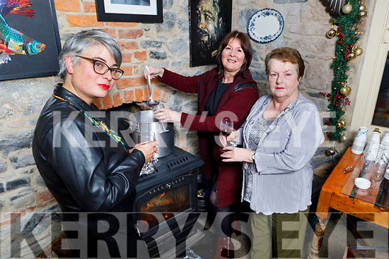 Cathy Troth, Caroline Hayes and Imelda Elmes tasting the mulled wine at the Johnny's Cottage Thanksgiving Special in Maddens, Milk Market Lane on Monday evening.