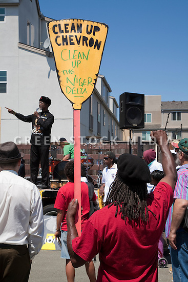 August 15, 2009. Dr. Henry Clark, Executive Director of the West County Toxics Coalition speaks. About two hundred people participated in a rally, march, and demonstration protesting Chevron's Richmond oil refinery renovation and expansion project. The event was organized by Mobilization for Climate Justice-West, a coalition of over thirty organizations, working to bring awareness to the refinery issue as well as the United Nations Climate Change Conference taking place in December in Copenhagen. Event organizers claim that the Richmond refinery project will allow the facility to refine heavier and dirtier crude that will result in more air pollution, greenhouse gas (GHGs) emissions, and health risks. A court ruling recently put the refinery project on hold saying that further environmental impact reporting was needed. Many protesters were also concerned about the environmental and human health impacts of oil company projects outside the United States. Richmond, California, USA