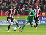 Chris Basham of Sheffield Utd and Josh Harrop of Preston North End during the championship match at the Bramall Lane Stadium, Sheffield. Picture date 28th April 2018. Picture credit should read: Simon Bellis/Sportimage