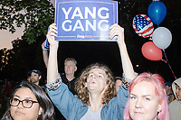 """People watch as entrepreneur and Democratic presidential candidate Andrew Yang speaks to a large crowd in Cambridge Common near Harvard Square in Cambridge, Massachusetts, on Mon., September 16, 2019. Yang's unlikely presidential bid is centered on his idea for a """"Freedom dividend,"""" which would give USD$1000 per month to every adult in the United States. After appearing in three Democratic party debates, Yang has risen in polls from longshot candidate to within the top 10."""