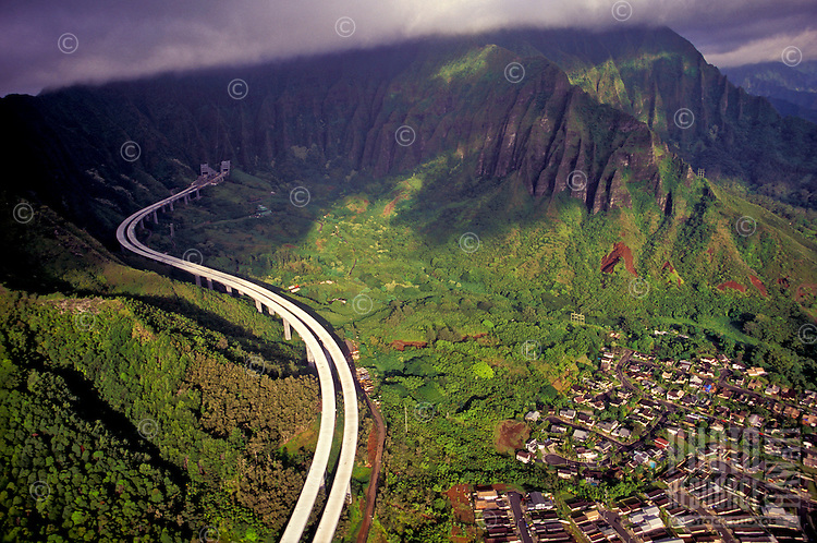 Aerial of the H3 highway, the Koolau Mountains, and a Kaneohe neighborhood