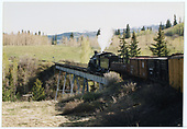 C&amp;TS #497 crossing Lobato trestle with a simulated freight train.<br /> C&amp;TS  Lobato, NM  Taken by Dorman, Richard L.