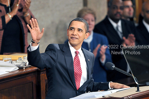 Washington, D.C. - February 24, 2009 -- United States President Barack Obama waves to the gallery as he begins to deliver an address to a Joint Session of Congress in the United States Capitol in Washington, D.C. on Tuesday, February 24, 2009..Credit: Ron Sachs / CNP.(RESTRICTION: NO New York or New Jersey Newspapers or newspapers within a 75 mile radius of New York City)