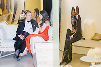 Politico reporter Hadas Gold (center right) and Chris Hooton sit in a lounge area toward the end of the night at the MSNBC After Party at the United States Institute of Peace in Washington, DC. Reflected in a golden panel at right, DNC worker Jenna Price and Capitol Hill worker Michael Hardaway also sit in the lounge. The party followed the annual White House Correspondents Association Dinner on Saturday, April 30, 2016. The party continued until about 3 AM on Sunday, May 1, 2016.
