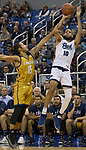 Nevada forward Caleb Martin (10) takes a jump shot over California Baptist guard Jordan Heading (15) in the first half of an NCAA college basketball game in Reno, Nev., Friday, Nov. 16, 2018. (AP Photo/Tom R. Smedes)