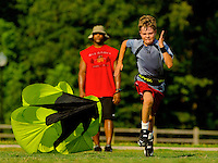A young athlete participates in preseason football Speed & Agility Training with Coach Greg Rhodes from Speed Killz. Both coach and athlete are model released.