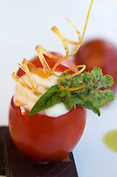Detail of a fresh tomato filled with cream of ricotta at the restaurant La Torre del Saraceno, Vico Equense in Italy