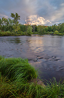 The Wisconsin River glows inder evening light at Council Grounds State Park in Lincoln County, Wisconsin
