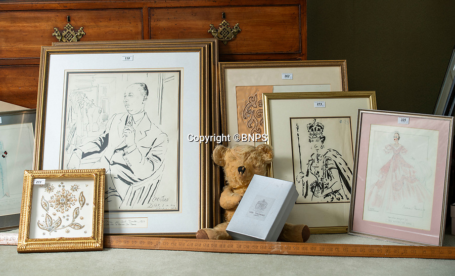 BNPS.co.uk (01202 558833)<br /> Pic: PhilYeomans/BNPS<br /> <br /> The house contains sketches and designs, and even Ian Thomas's teddy bear.<br /> <br /> A remarkable 'time warp' Royal archive amassed by the Queen's dressmaker has been found inside his old country home.<br /> <br /> The late Ian Thomas was a dress designer for members of the Royal Family, including Her Majesty, for over 30 years.<br /> <br /> As an apprentice he worked alongside the renowned fashion designer Norman Hartnell on creating the Queen's coronation dress in 1953.<br /> <br /> His archive includes embroidered samples of the gown worn by Elizabeth II for the historic ceremony in Westminster Abbey that was broadcast to millions.<br /> <br /> Mr Thomas also designed outfits for the Queen Mother and Princess Margaret.