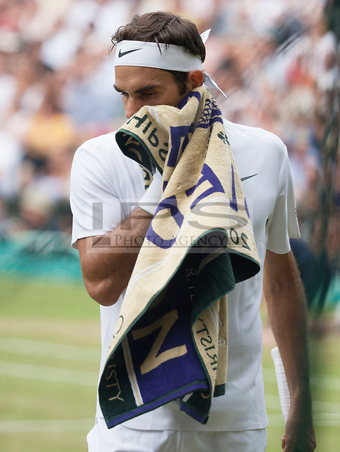 Roger Federer (SUI) wipes his face during Mens Final match against Marin Cilic (CRO), Wimbledon Championships 2017, Day 13, Mens Final, All England Lawn Tennis & Croquet Club, Church Rd, London, United Kingdom - 16th July 2017