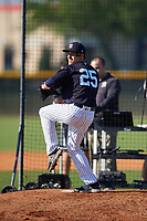 New York Yankees Danny Farquhar (25) throws on a side field while wearing a protective hat made by Unequal Technologies during a Minor League Spring Training game against the Philadelphia Phillies on March 23, 2019 at the New York Yankees Minor League Complex in Tampa, Florida.  (Mike Janes/Four Seam Images)