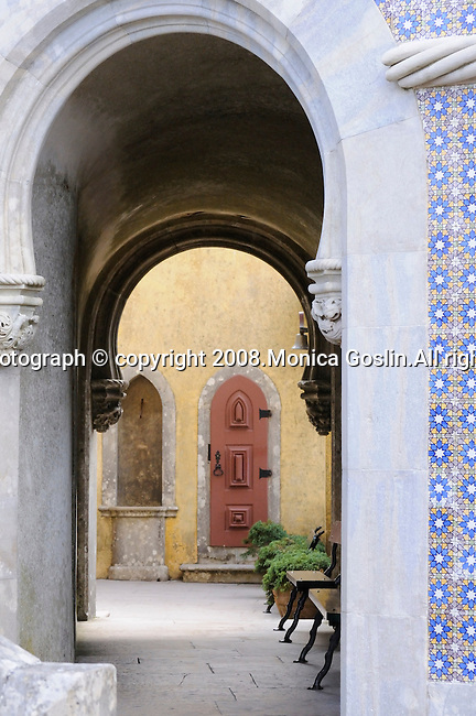 An archway leading to a small courtyard at the Pena National Palace in Sintra, Portugal.
