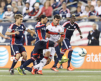 D.C. United midfielder Chris Pontius (13) works to control the ball as New England Revolution midfielder Lee Nguyen (24) defends. In a Major League Soccer (MLS) match, the New England Revolution (blue) defeated D.C. United (white), 2-1, at Gillette Stadium on September 21, 2013.