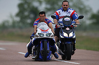 Apr. 27, 2013; Baytown, TX, USA: A crew member pushes NHRA pro stock motorcycle rider Hector Arana Jr (left) during qualifying for the Spring Nationals at Royal Purple Raceway. Mandatory Credit: Mark J. Rebilas-