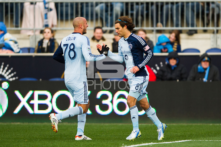 Graham Zusi (8) of Sporting Kansas City celebrates scoring with Aurelien Collin (78) during the first half against the Philadelphia Union during a Major League Soccer (MLS) match at PPL Park in Chester, PA, on March 2, 2013.