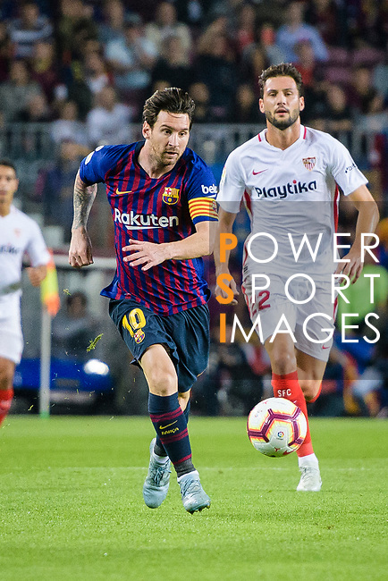 Lionel Messi of FC Barcelona runs with the ball during the La Liga 2018-19 match between FC Barcelona and Sevilla FC at Camp Nou Stadium on October 20 2018 in Barcelona, Spain. Photo by Vicens Gimenez / Power Sport Images