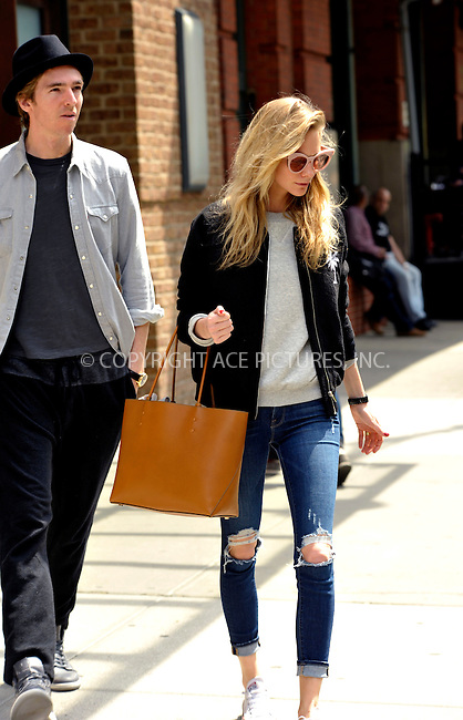 WWW.ACEPIXS.COM<br /> <br /> May 5 2015, New York City<br /> <br /> Poppy Delevingne and her husband James Cook leave a dowtown hotel on May 5 2015 in New York City<br /> <br /> By Line: Curtis Means/ACE Pictures<br /> <br /> <br /> ACE Pictures, Inc.<br /> tel: 646 769 0430<br /> Email: info@acepixs.com<br /> www.acepixs.com