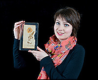 BNPS.co.uk (01202 558833)<br /> Pic: RachelAdams/BNPS<br /> <br /> ***Please use full byline***<br /> <br /> Auctioneer Amy Brennan holds the acrylic-encased poppy.<br /> <br /> The oldest surviving poppy from the bloody battlefields of the First World War has emerged for sale almost 100 years after it was first picked.<br /> <br /> The vivid red flower was taken from the front-line trenches of Arras in northern France by 17-year-old British soldier Private Cecil Roughton in 1916.<br /> <br /> The poppy is thought to be the oldest in Britain and one of only two that survived from the First World War.<br /> <br /> It is expected to sell for &pound;1,000 when it goes under the hammer at Duke's Auctioneers in Dorchester, Dorset.
