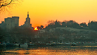 Pope's Palace in Avignon and the Rhone river in haze at sunset, Vaucluse, Rhone, Provence, France