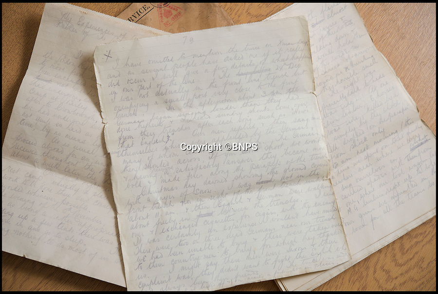 BNPS.co.uk (01202 558833)<br /> Pic: PhilYeomans/BNPS<br /> <br /> Xmas truce letter...<br /> <br /> Found in a old suitcase...poignant letters and photographs from the trenches of the Western Front.<br /> <br /> Germans who fought in the First World War never wanted to kill their English 'Saxon friends', according to a never-before-seen account of the famous Christmas truce of 1914.<br /> <br /> Lieutenant Hugh Barker included the previously-unknown description of the friendly meeting between the warring parties in a letter home to his mother.<br /> <br /> He described how the enemy soldiers he met were from the Saxony region of northern Germany and how they expressed their bemusement and displeasure at having to fight their Anglo-Saxon cousins.<br /> <br /> Lt Barker also documented the carols and banter the two sides exchanged across No Man's Land before both groups of men felt emboldened enough to emerge from their trenches.<br /> <br /> The archive is tipped to sell for £3,000 with C & T Auctions of Ashford, Kent on April 30.